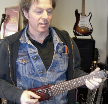Phil with Lapstick travel guitar