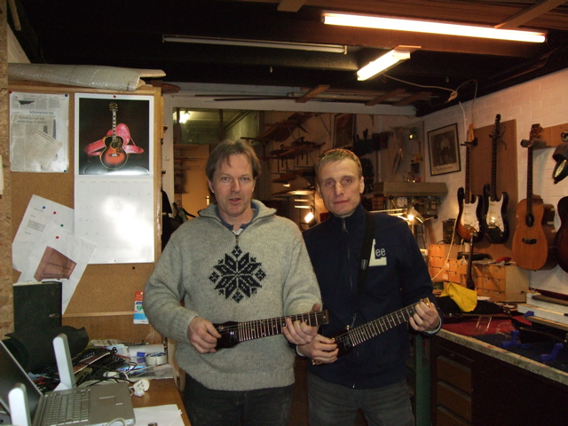 Phil and customer with Lapstick travel guitar